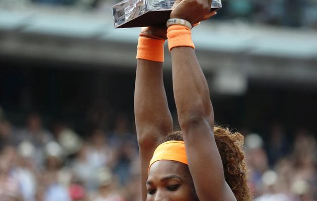 Serena Williams radieuse après son triomphe à Roland-Garros, le 9 juin 2013 à Paris [Thomas Coex / AFP]