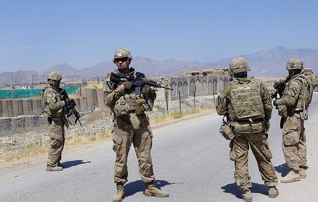 Des soldats de l'ISAF gardent une route près de Laghman, en Afghanistan, le 5 juin 2013 [Waseem Nikzad / AFP/Archives]