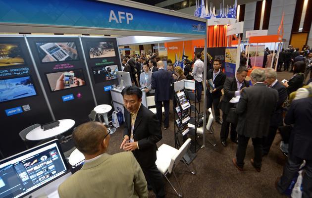 Le stand AFP au congrès annuel de l'Association mondiale des journaux et éditeurs de médias d'information (Wan-Ifra), le 3 juin 2013 à Bangkok [Pornchai Kittiwongsakul / AFP]