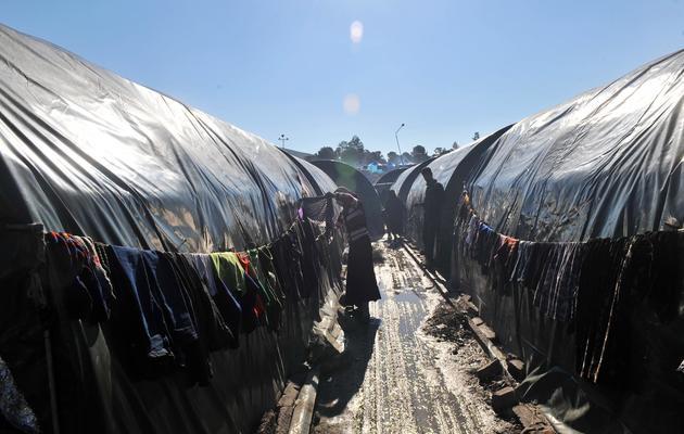Des réfugiés syriens le 18 mars 2013 dans le camp Bab al-Hawa à la frontière entre la Syrie et la Turquie [Bulent Kilic / AFP/Archives]