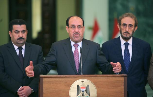 Le Premier ministre irakien Nouri al-Maliki (c), le 7 mai 2013 [Ahmad al-Rubaye / AFP/Archives]