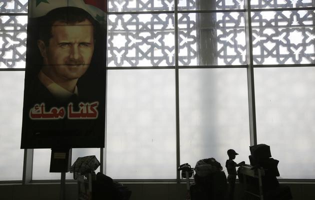 Portrait de Bachar al-Assad à l'aéroport de Damas, le 15 mai 2013 [Joseph Eid / AFP/Archives]