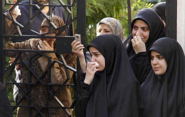 Des femmes libanaises pleurent la mort de membres du Hezbollah, à Beyrouth, le 20 mai 2013 [ / AFP]