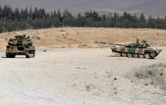 Des tanks de l'armée syrienne prennent position près de la ville de Qousseir le 25 mai 2013 [ / AFP/Archives]