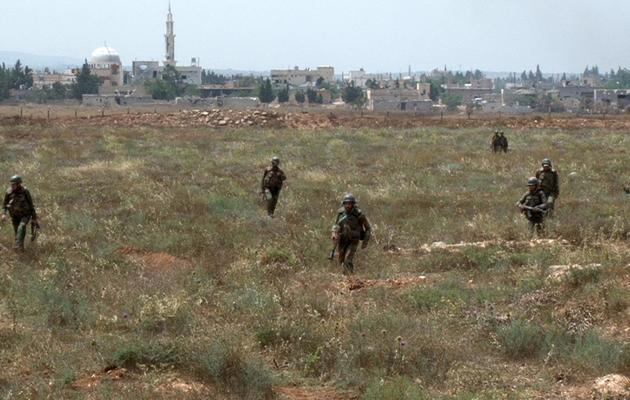 Photo transmise par l'agence syrienne Sana, de soldats près de l'aéroport militaire de Dabaa, dans la région de Qousseir, le 30 mai 2013 [ / SANA/AFP/Archives]