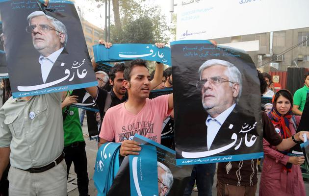 Des partisans de Mohammad Reza Aref font campagne pour leur candidat, le 6 juin 2013 à Téhéran [Atta Kenare / AFP/Archives]