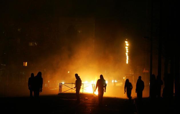 Des manifestants font face à la police, le 26 novembre 2007 à Villiers-le-Bel [Olivier Laban-Mattei / AFP/Archives]