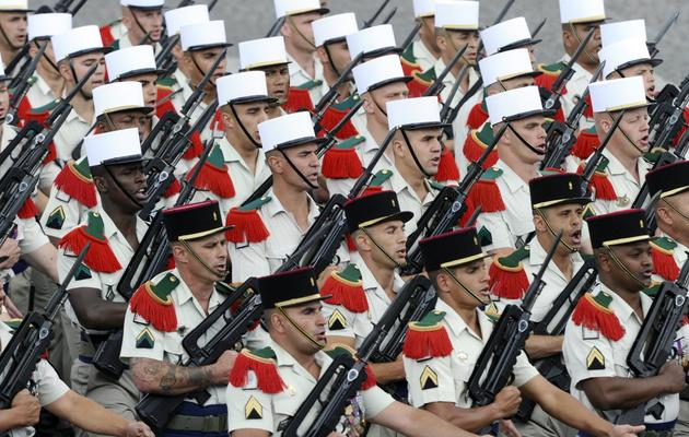 Des soldats du 4è régiment étranger de Castelnaudary défilent le 14 juillet 2011 sur les Champs-Elysées [Miguel Medina / AFP]