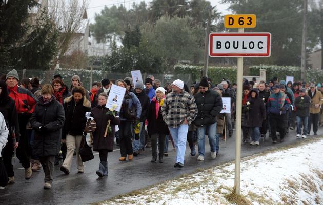 Des personnes participent à une marche blanche, le 14 février 2012 dans le village de Bouloc, un an après la disparition de Patricia Bouchon [Remy Gabalda / AFP/Archives]