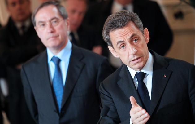 Claude Guéant (G) et Nicolas Sarkozy (D), le 13 avril 2013 à Ajaccio [Pascal Pochard-Casabianca / AFP/Archives]