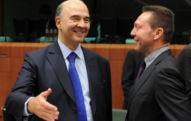Les ministres français de l'Economie Pierre Moscovici et grec des Finances Ioannis Stournaras, le 20 novembre 2012 à Bruxelles [John Thys / AFP/Archives]