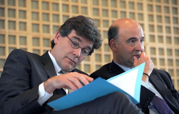 Le ministre du Redressement productif Arnaud Montebourg (g) et le ministre de l'Economie, Pierre Moscovici, le 9 janvier 2013 à Paris [Eric Piermont / AFP/Archives]