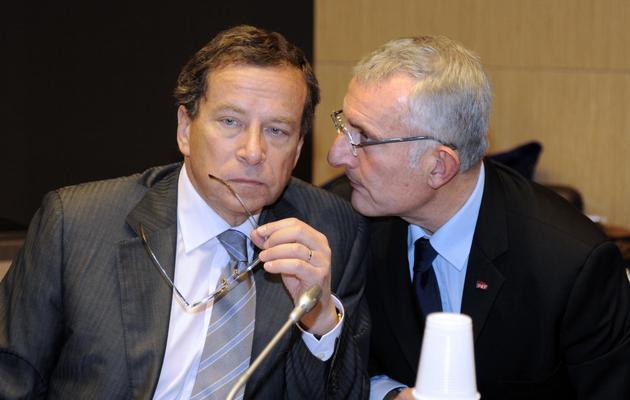 Le président de Réseau ferré de France (RFF) Jacques Rapoport (g) et le président de la SNCF Guillaume Pepy lors d'une rencontre à l'Assemblée nationale à Paris, le 30 janvier 2013 [Bertrand Guay / AFP/Archives]