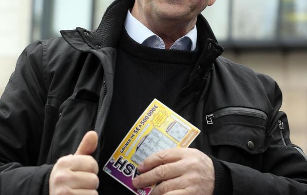 Robert Riblet, qui assigne en justice la Française des jeux, le 23 avril 2013 à Boulogne-Billancourt [Jacques Demarthon / AFP]