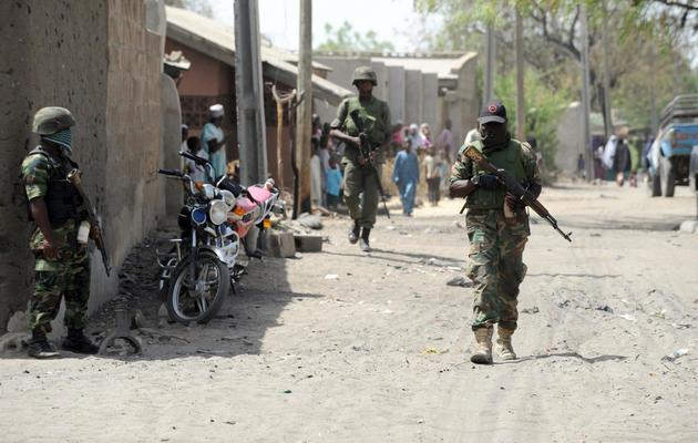 Des militaires nigérians patrouillent à Baga dans l'état de Borno au Nigeria, le 30 avril 2013 [Pius Utomi Ekpei / AFP/Archives]
