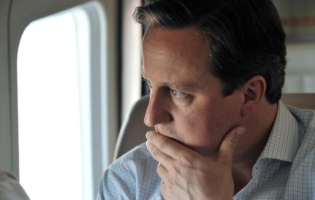Le Premier ministre britannique David Cameron, le 10 mai 2013 dans un hélicoptère en Russie [Alexey Nikolsky / Ria Novosti/AFP/Archives]