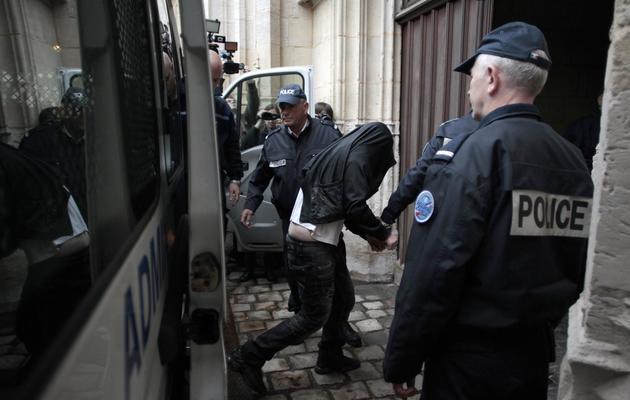 Un des jeunes gens accusés d'avoir froidement exécuté Alexandre, arrive au tribunal de Rouen, le 21 mai 2013 [Charly Triballeau / AFP]