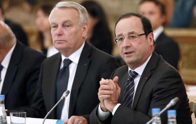 Le Premier ministre Jean-Marc Ayrault (D) et le président François Hollande, le 29 mai 2013 [Charles Platiau / Pool/AFP]