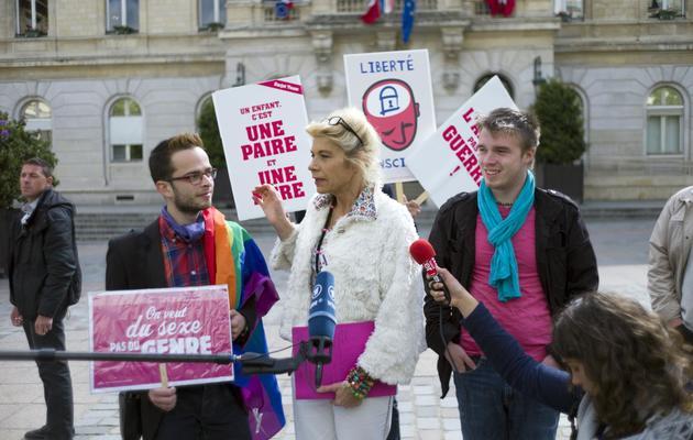 Frigide Barjot (c), Clément Borioli (g) de Homovox.com et Xavier Bongibault, le 29 mai 2013 à Paris [Fred Dufour / AFP/Archives]