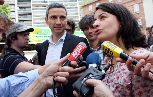 Christophe Nadjovski et Cécile Duflot, le 8 juin 2013 à Paris [Thomas Samson / AFP]
