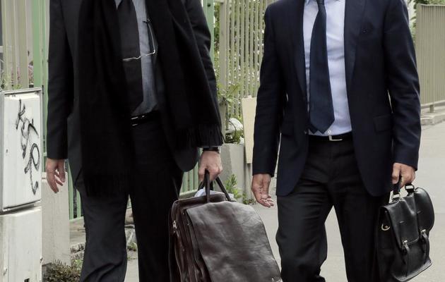 Jean-Etienne Giamarchi (d), avocat de Stéphane Richard, et Jean-Alain Michel, avocat de Jean-François Rocchi, le 11 juin 2013 à Paris [Jacques Demarthon / AFP]