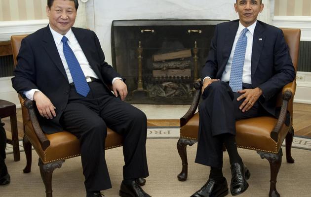 Barack Obama et Xi Jinping, alors vice-président de la Chine, le 14 février 2012 à la Maison Blanche à Washington [Saul Loeb / AFP/Archives]