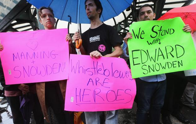 Des supporters d'Edward Snowden sont rassemblés sur une place de New York, le 10 juin 2013 [Mario Tama / Getty Images/AFP]