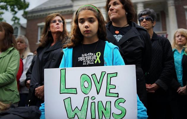 Cecilia Floros, 10 ans, participe à l'hommage aux victimes du massacre, le 14 juin 2013 à Newtown [Spencer Platt / Getty Images/AFP/Archives]