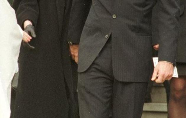 John F. Kennedy Jr et sa femme  Carolyn Bessette-Kennedy aux funérailles de Michael Kennedy, le 3 janvier 1998 dans le Massachusetts [John Mottern / AFP/Archives]