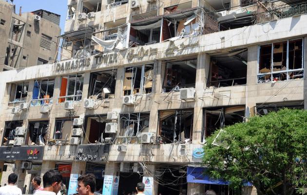 Photo de l'agence de presse syrienne officielle Sana montrant un hôtel détruit de Damas, le 30 avril 2013 [- / SANA/Sana/AFP/Archives]