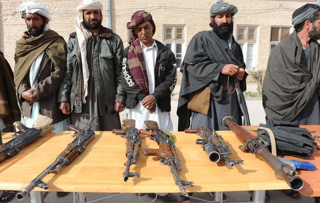 Des talibans déposent les armes à Herat dans l'ouest de l'Afghanistan, le 19 mars 2013 [Aref Karimi / AFP/Archives]