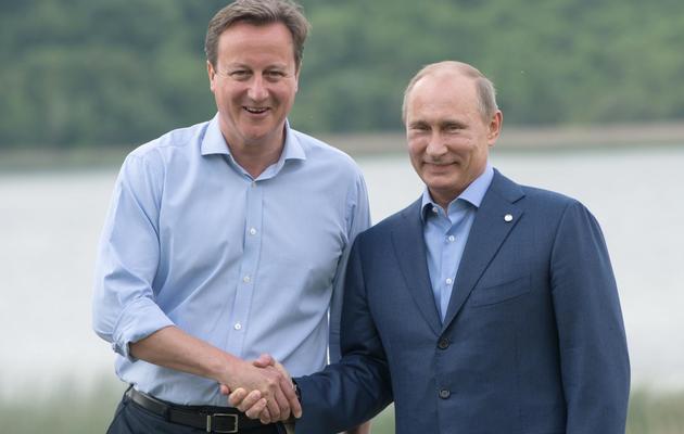 David Cameron (G) et Vladimir Poutine en Irlande du Nord pour le sommet du G8, le 17 juin 2013  [Bertrand Langlois / AFP]