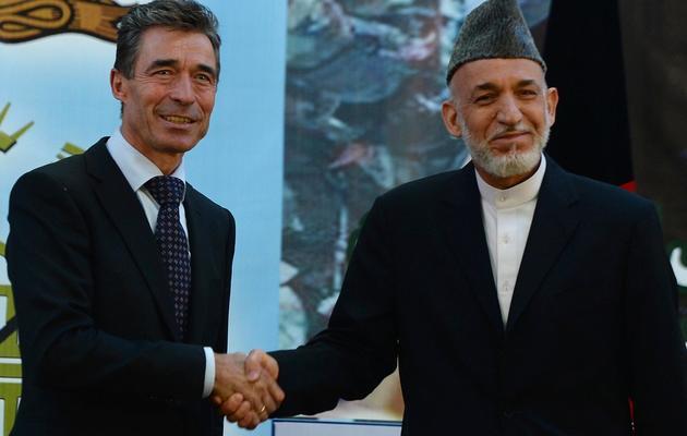 Le secrétaire général de l'Otan  Anders Fogh Rasmussen et le président Hamid Karzai le 18 juin 2013 à Kaboul [Shaf Marai  / AFP]