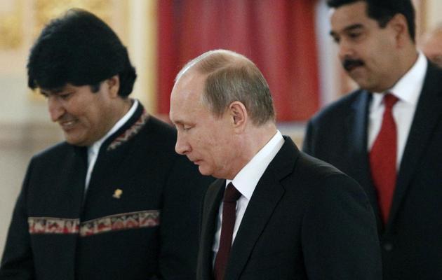 Le président bolivien Evo Morales, le président russe Vladimir Poutine et le président vénézuélien Nicolas Maduro, au Kremlin, à Moscou, le 1er juillet 2013 [Maxim Shemetov / Pool/AFP]