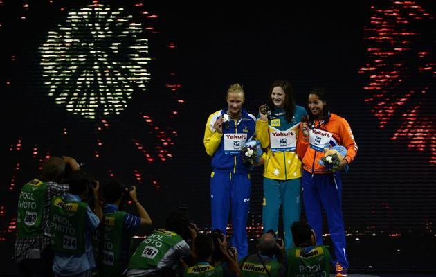 l'Australienne Cate Campbell en or, la Suédoise Sarah Sjostrom en argent, la Néerlandaise Ranomi Kromowidjojo en bronze, le 2 août 2013. [Pierre-Philippe Marcou / AFP]
