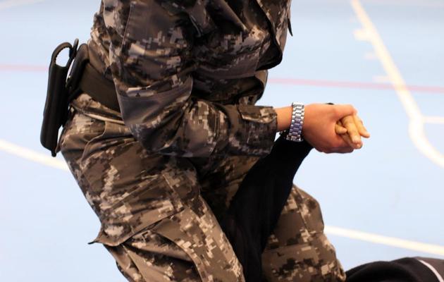 Des policières palestiniennes à l'entraînement à Jéricho, le 20 février 2014 [Abbas Momani / AFP]
