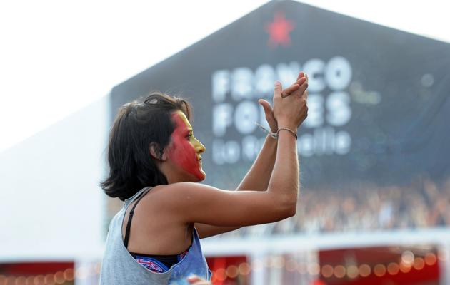 Une jeune femme lors d'un concert le 13 juillet 2013 aux Francofolies de La Rochelle [Xavier Leoty / AFP Photo]