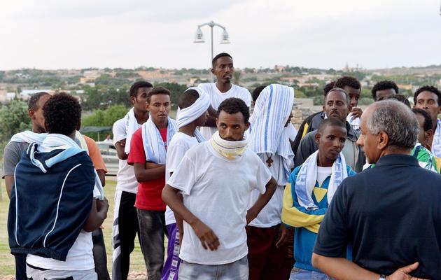 Des migrants érythréens à Lampedusa, le 5 octobre 2013 après le naufrage d'un bateau [Alberto Pizzoli / AFP]
