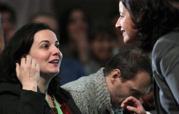 Emmanuelle Cosse (g) et Cécile Duflot au congrès EELV à Caen, le 30 novembre 2013 [Charly Triballeau / AFP]