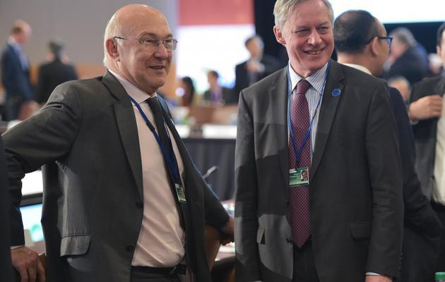 Michel Sapin et Christian Noyer le 10 avril 2014 pour le G20 à Washington  [Mandel Ngan / AFP]