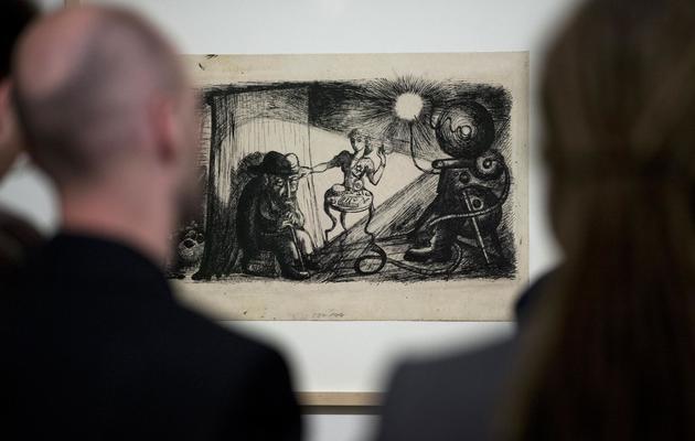 """Le dessin """"Film and Reality"""" (1944) du Tchèque Bedrich Fritta, exposé au Musée juif de Berlin, le 15 mai 2013 [John Macdougall / AFP]"""