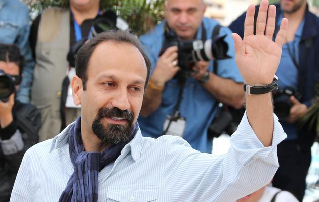 """L'Iranien Asghar Farhadi pose, le 17 mai 2013, au Festival de Cannes pour la présentation du film """"Le Passé"""" [Loic Venance / AFP]"""