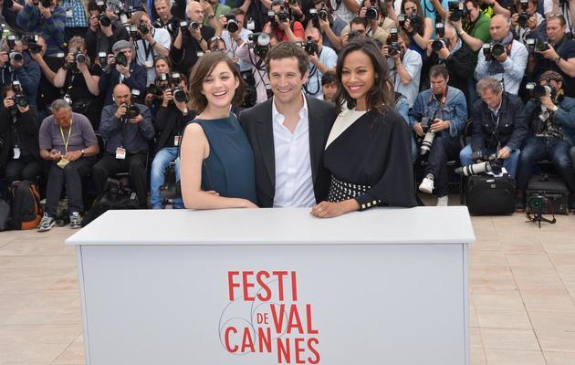 L'acteur-réalisateur Guillaume Canet et les actrices Marion Cotillard et Zoé Saldana, le 20 mai 2013 à Cannes [Alberto Pizzoli / AFP]
