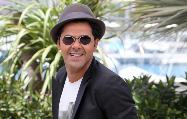 """Jamel Debbouze pose, le 21 mai 2013 au festival de Cannes, pour la présentation du film """"Né quelque part"""" [Loic Venance / AFP]"""
