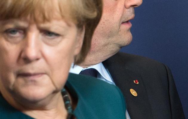 La chancelière allemande Angela Merkel et le président français François Hollande à Bruxelles le 22 mai 2013 [Bertrand Langlois / AFP]