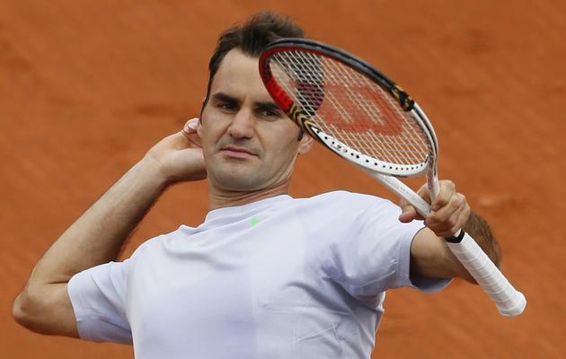 Le Suisse Roger Federer exulte après sa victoire au 1er tour de Roland-Garros, le 26 mai 2013 à Paris [Patrick Kovarik / AFP]