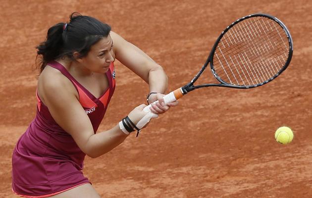 La Française Marion Bartoli lors de son match contre l'Italienne Francesca Schiavone au 3e tour de Roland-Garros le 1er juin 2013. Bartoli a perdu 6-2, 6-1. [Patrick Kovarik / AFP]
