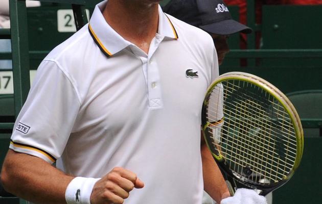 Richard Gasquet après sa victoire contre l'Allemand Florian Mayer lors du tournoi ATP sur gazon de Halle, le 14 juin 2013 [Carmen Jaspersen / AFP]
