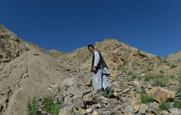 Morad Ali, un chercheur d'or afghan, le 7 mai 2013 à Qara Zaghan dans la province de Baghlan [Shah Marai / AFP]