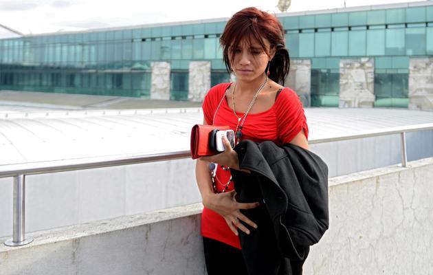 La petite amie de John McAfee, Sam, à l'aéroport d'Aurora, le 12 décembre 2012 à Guatemala City [Johan Ordonez / AFP]